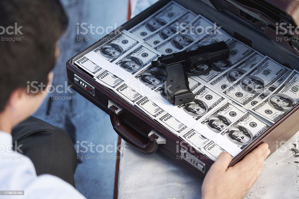 Opening a briefcase filled with economic deception royalty-free stock photo