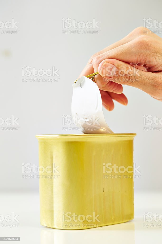 Opening a can stock photo