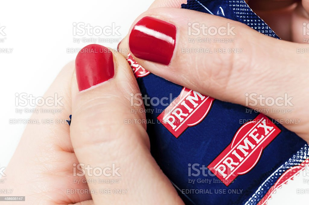 Opening a condom pocket royalty-free stock photo