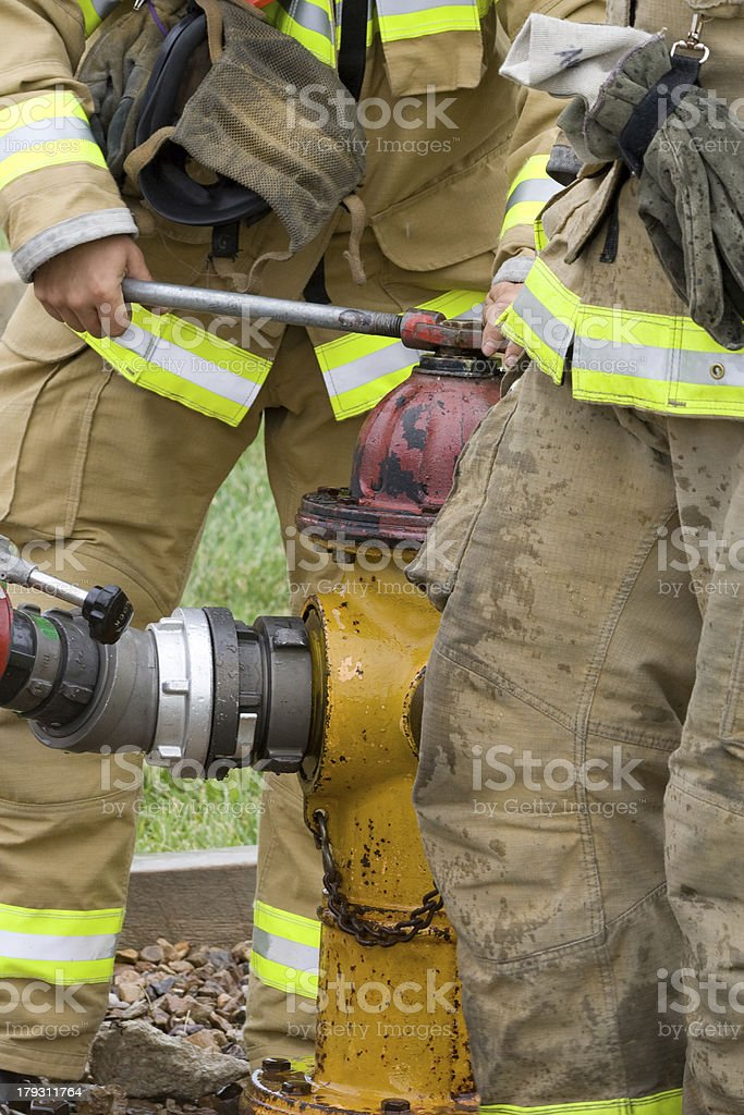 Opening a Fire Hydrant stock photo