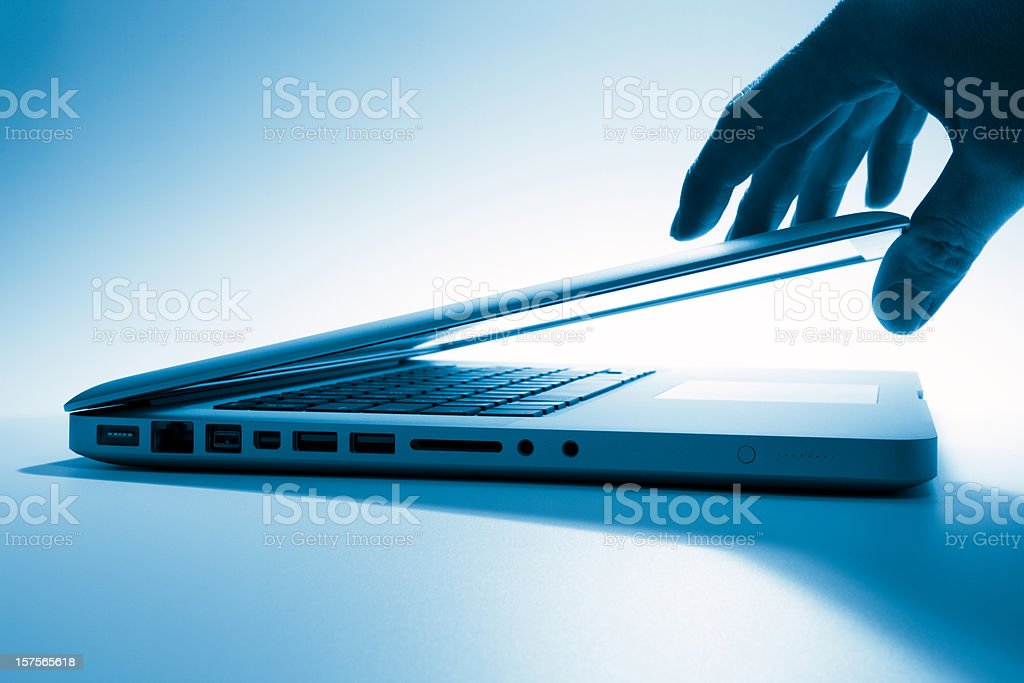 Opening a laptop screen royalty-free stock photo