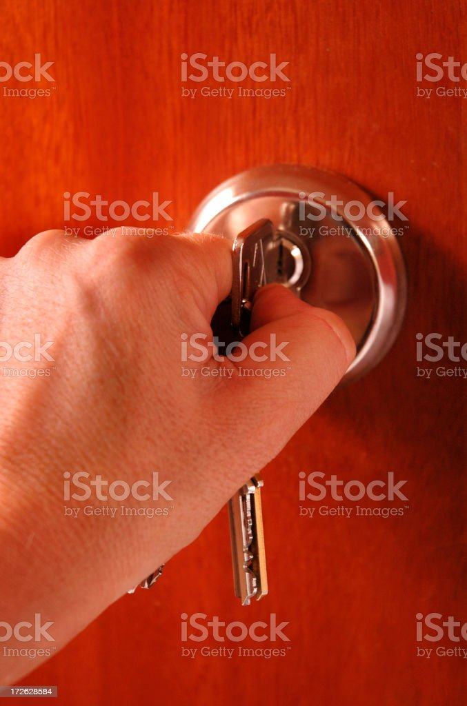 Opening a lock royalty-free stock photo