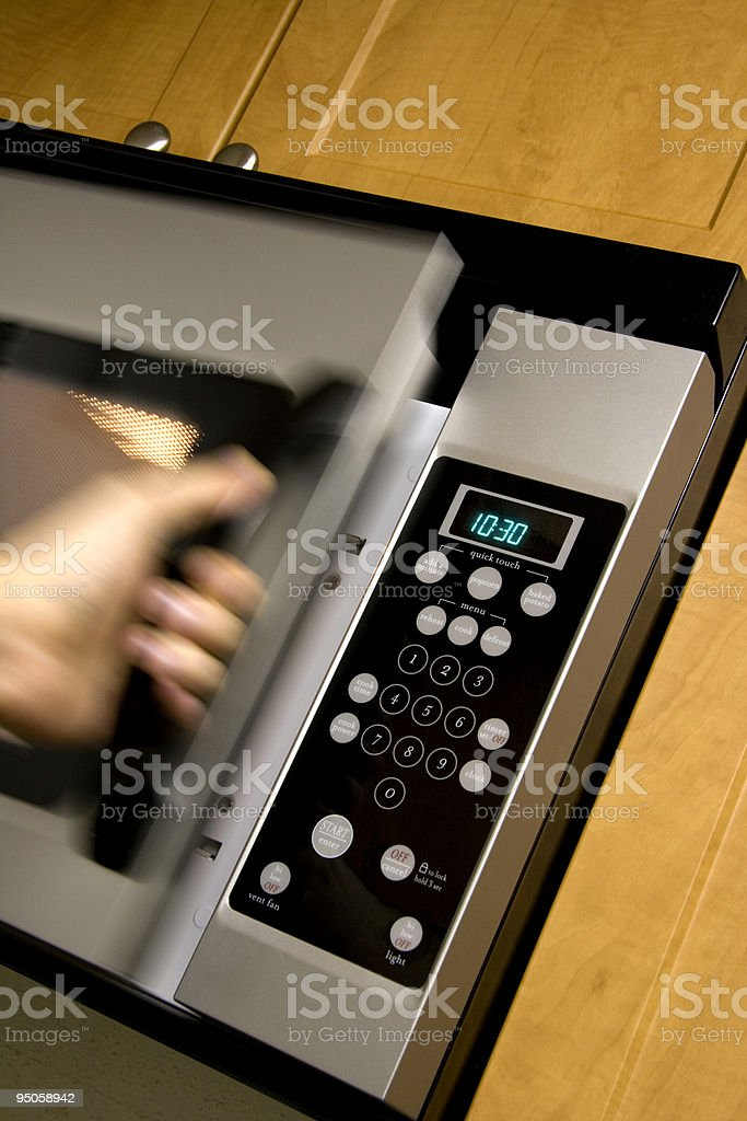 Opening a microwave door royalty-free stock photo