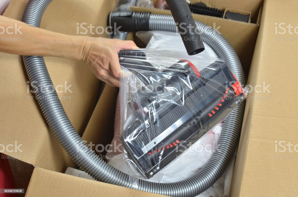 Opening a modern vacuum cleaner stock photo