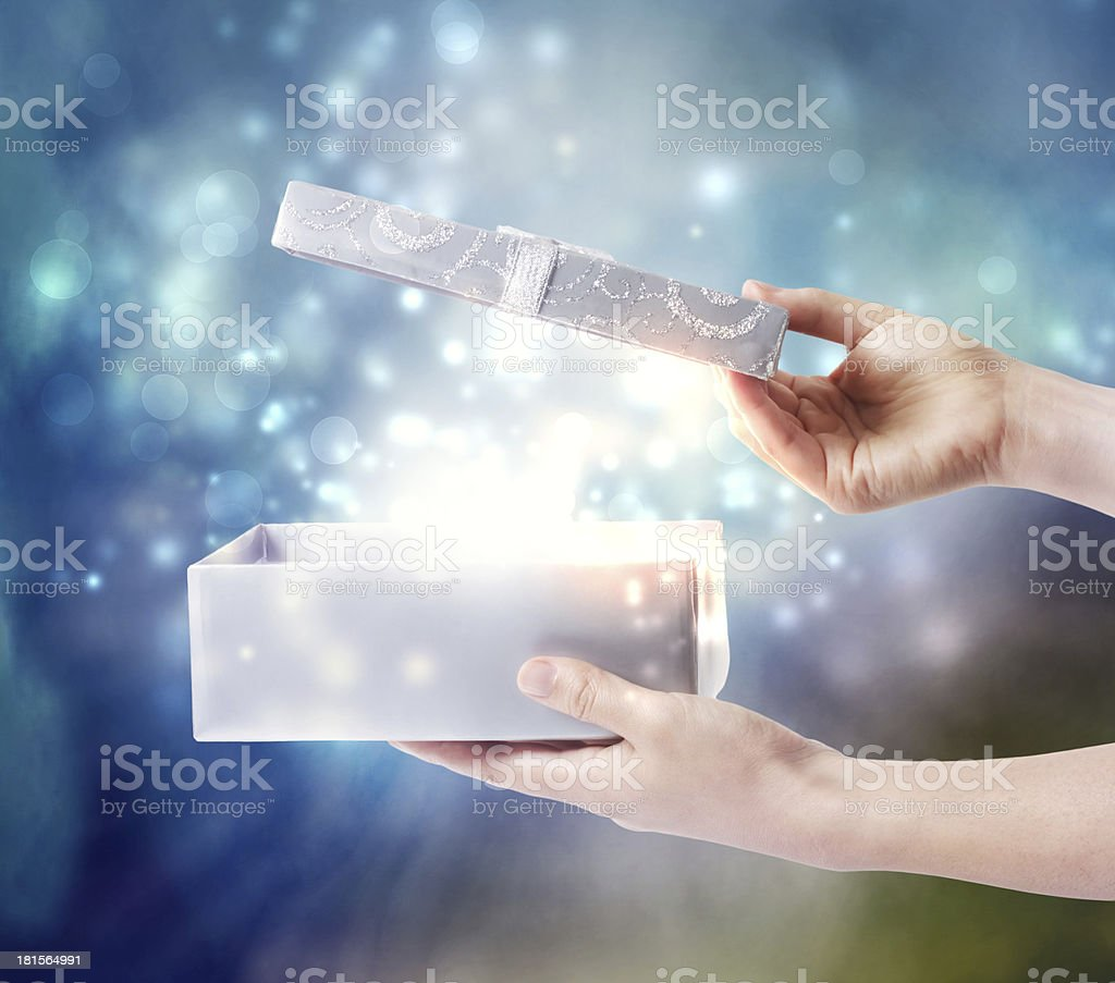 Opening a special present box stock photo