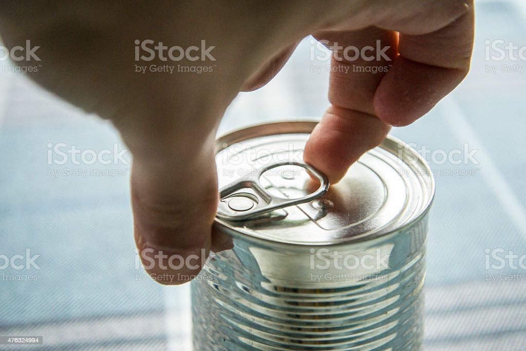Opening a tin stock photo