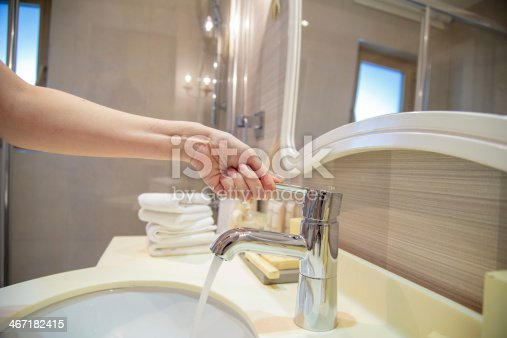 istock opening a water tap 467182415