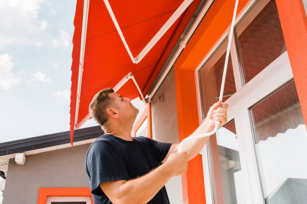 opening awning man opens awning above pvc balcony door awning stock pictures, royalty-free photos & images