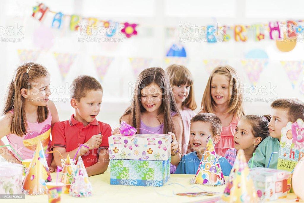 Opening birthday presents. stock photo