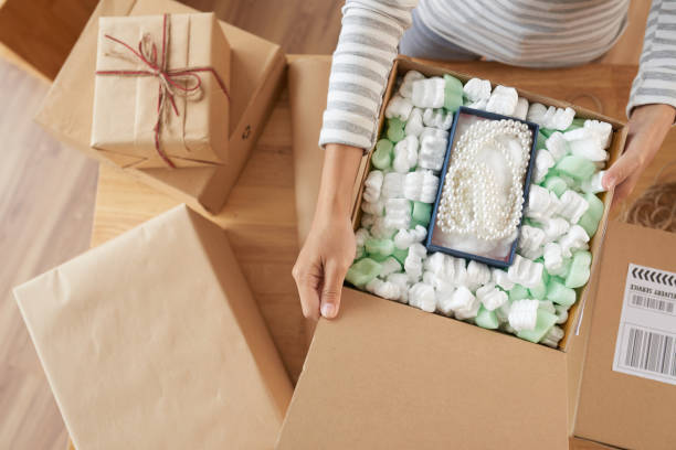 opening boxes - fragile stock pictures, royalty-free photos & images