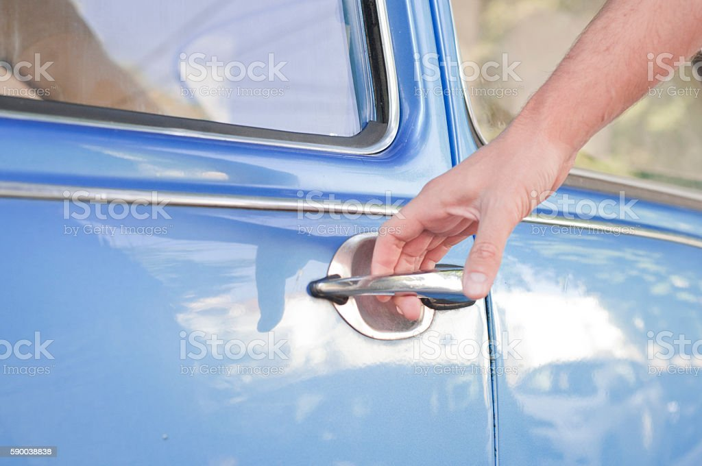 Opening car door, Man hand opening car door, close up stock photo