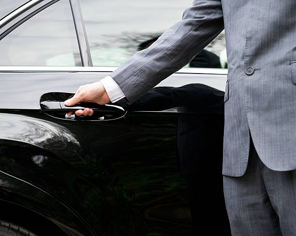 opening car door - limousine service stock photos and pictures