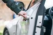 istock Opening car door 667701150