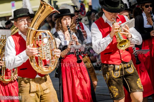 Munich, Germany - September 21, 2019: Opening parade of the world-famous Oktoberfest in Munich with music band in historical and traditional costumes. The Oktoberfest is the biggest beer festival of the world.