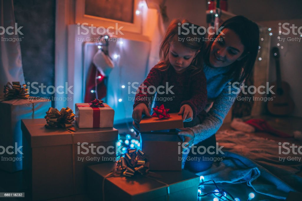 Opening Christmas present with my mom stock photo