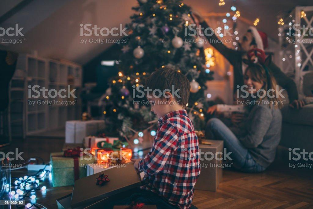 Opening Christmas presents stock photo