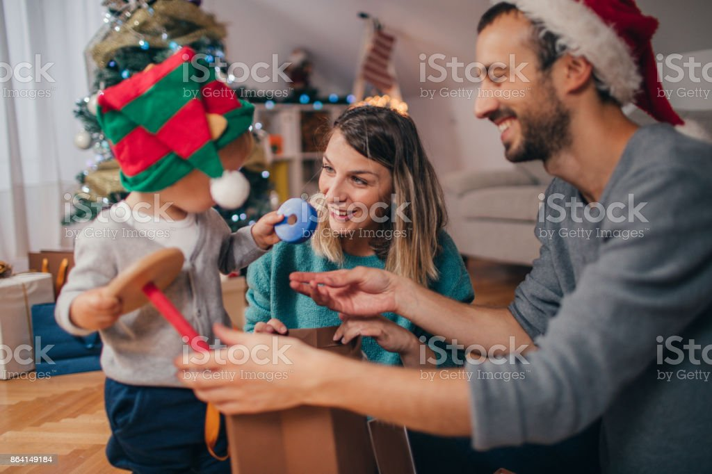 Opening Christmas presents royalty-free stock photo