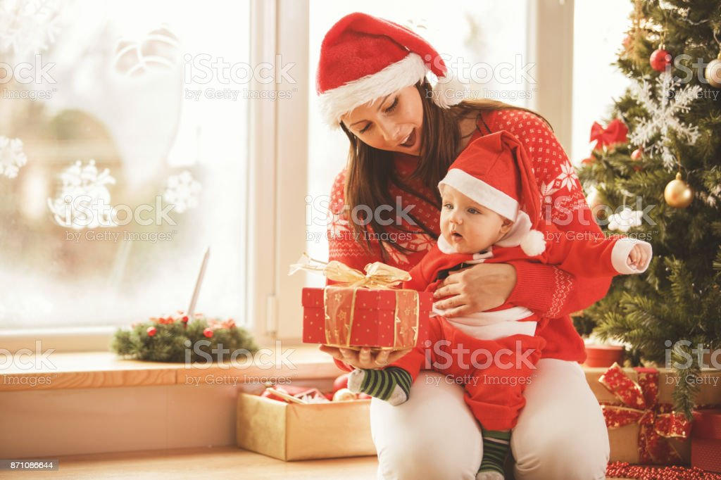 Opening Christmas presents stock photo