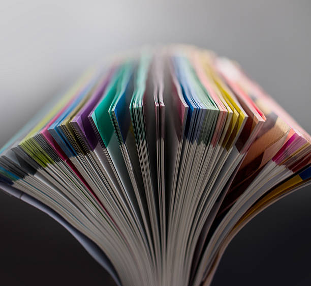 opening colorful pages - catalogue stock photos and pictures
