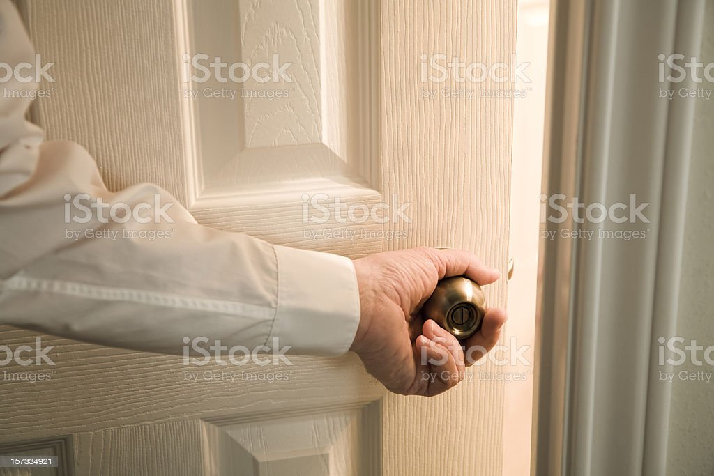 opening door into light unknown room stock photo