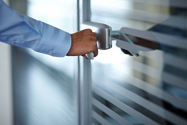 Opening door Male hand opening office door entering stock pictures, royalty-free photos & images