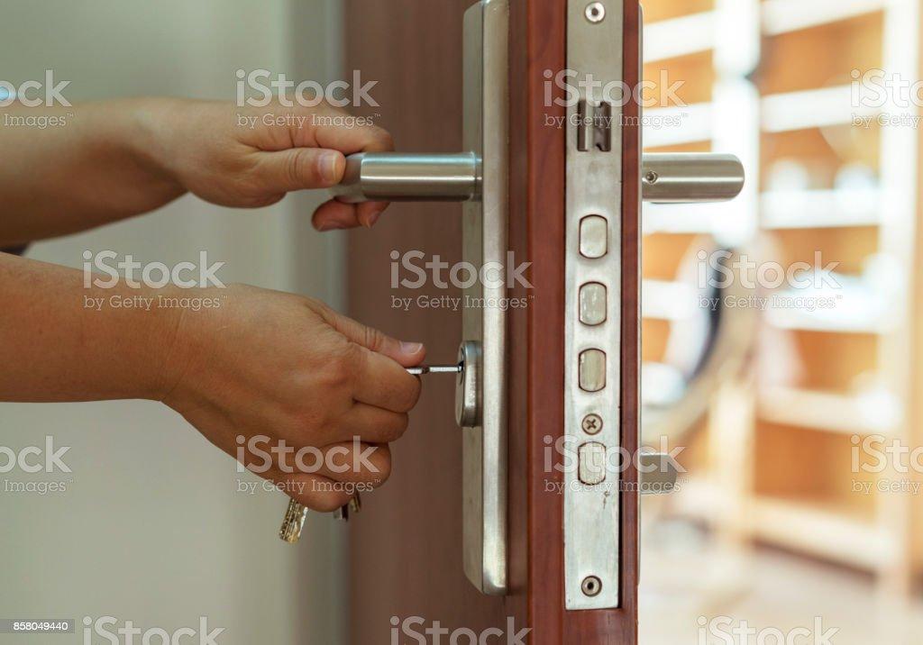opening door with key stock photo