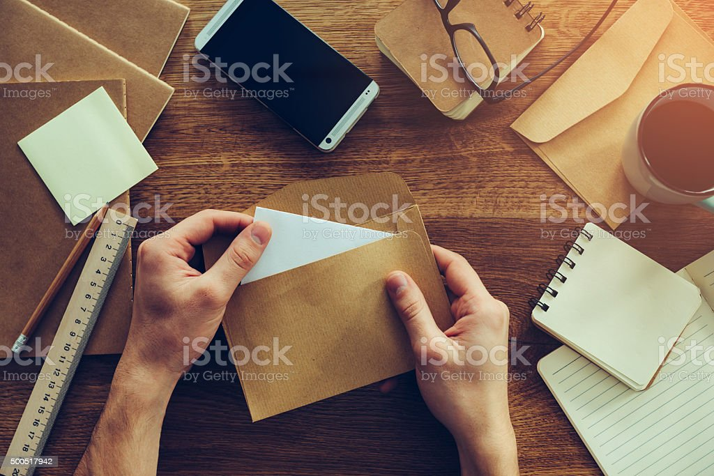 Opening envelope. stock photo
