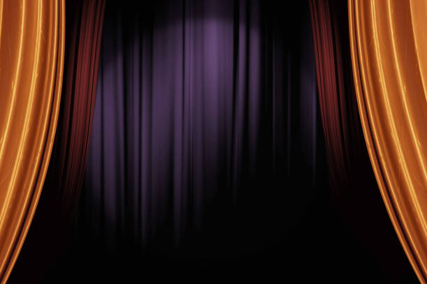 opening gold and red stage curtains in dark theater for a live performance background - цирк стоковые фото и изображения