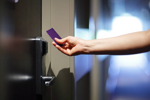 Opening hotel door with keyless entry card Opening a hotel door with keyless entry card cardkey stock pictures, royalty-free photos & images
