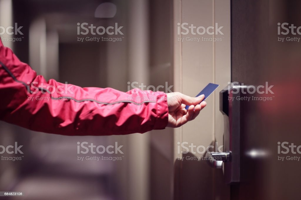 Opening hotel door with keyless entry card stock photo