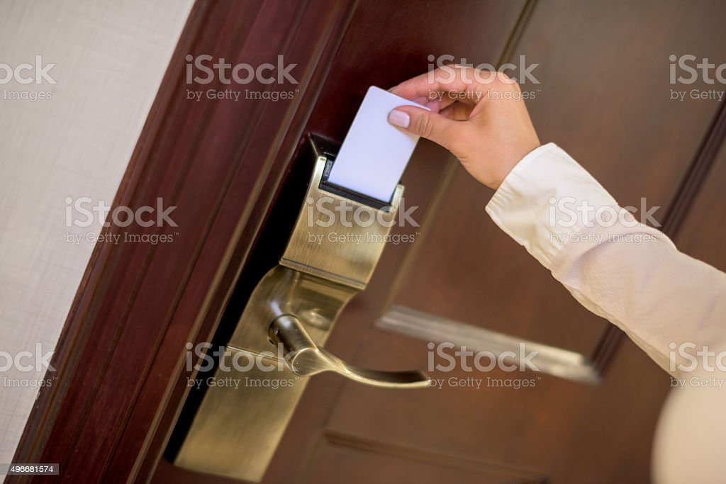 Opening hotel room with a cardkey stock photo