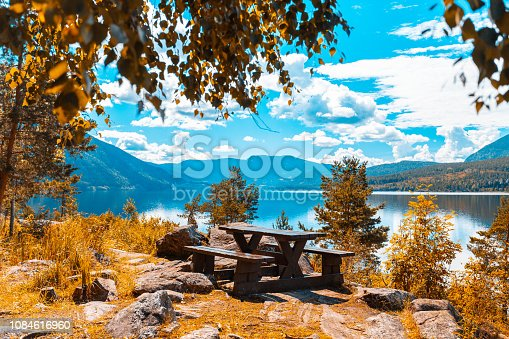Norway, Forest, Fjord, Scenic View, Mountain - Lonely bench hidden in a quiet corner in a forest in Norway, overlooking a fjord with mountains around it.