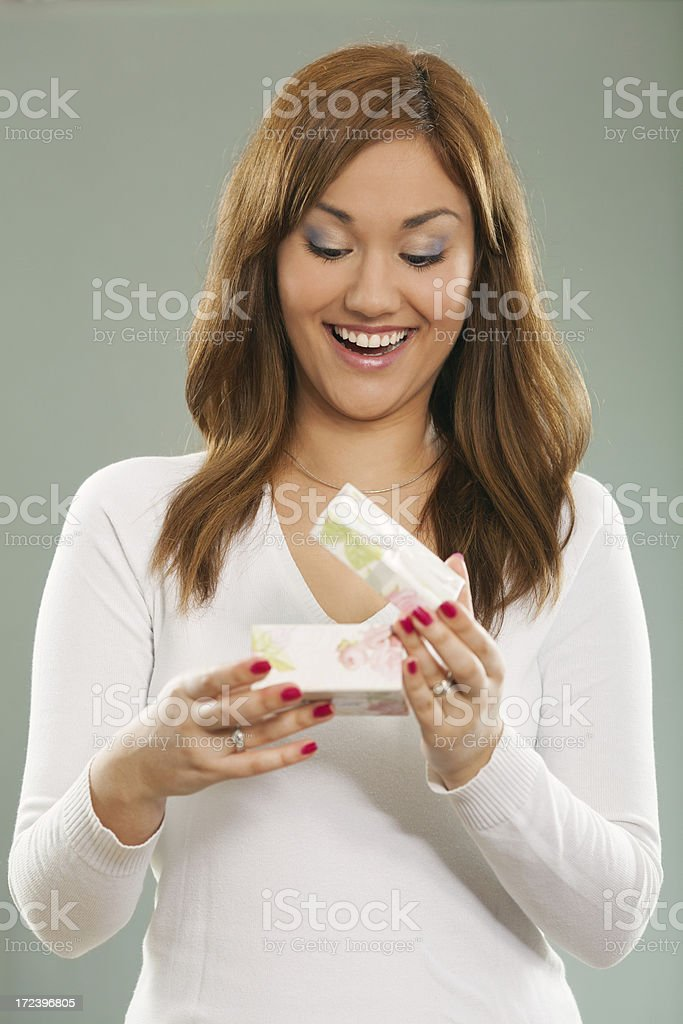 Opening lid of a holiday gift royalty-free stock photo