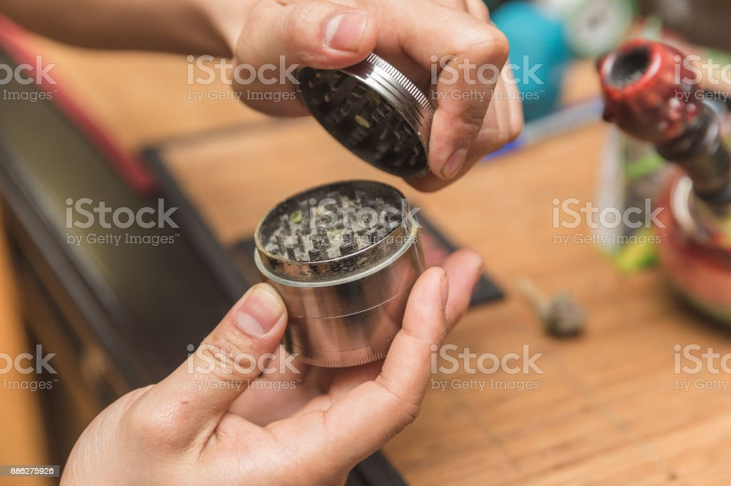 Opening Metal Cannabis Grinder stock photo