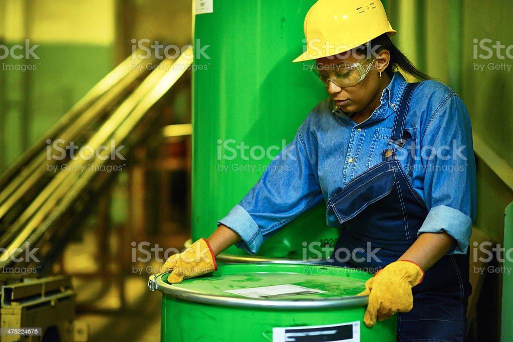 Opening oil drum stock photo
