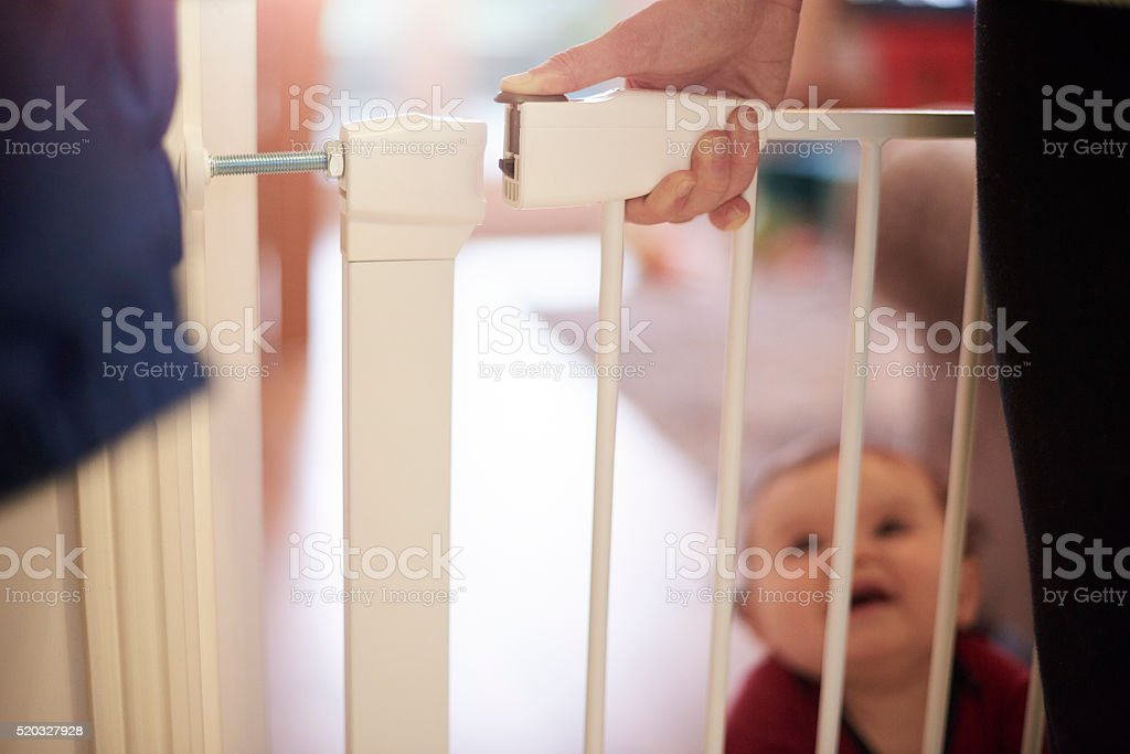 Opening or closing baby safety gate stock photo