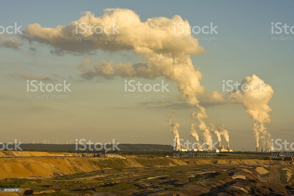 Open-pit lignite mining in sunset stock photo