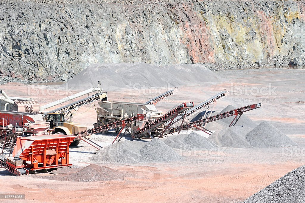 Open-pit Mine Quarry with conveyor belts crushing stones stock photo