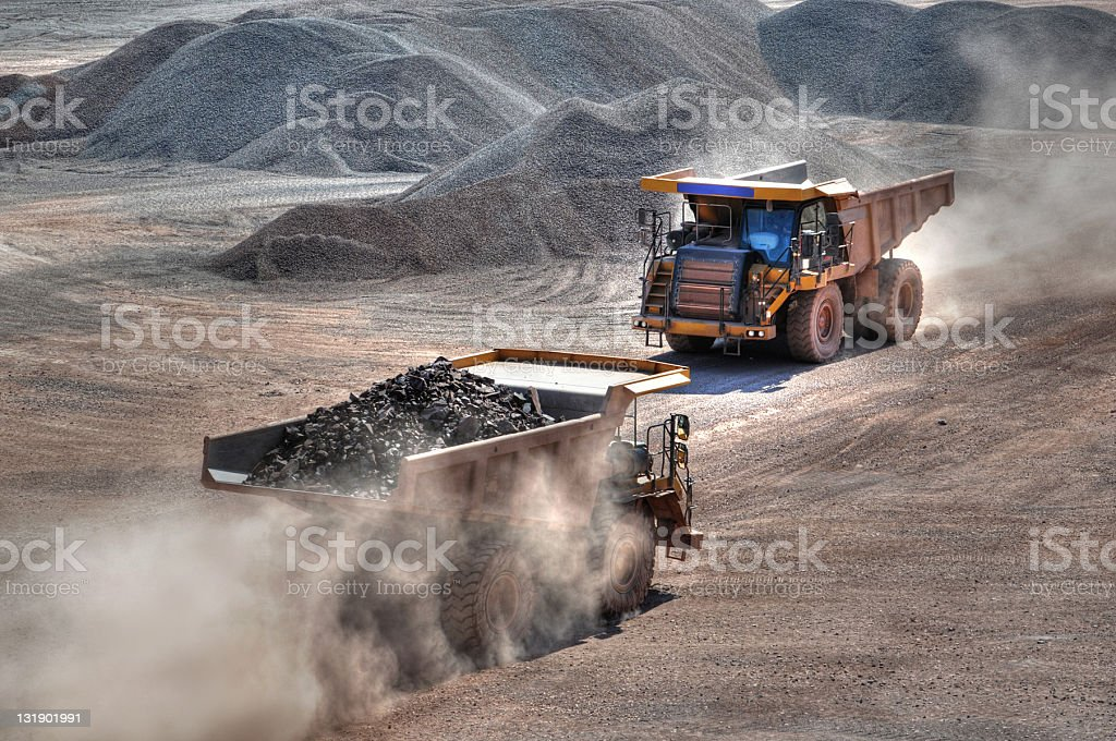 HDR Open-pit Mine with two Dump Trucks stock photo