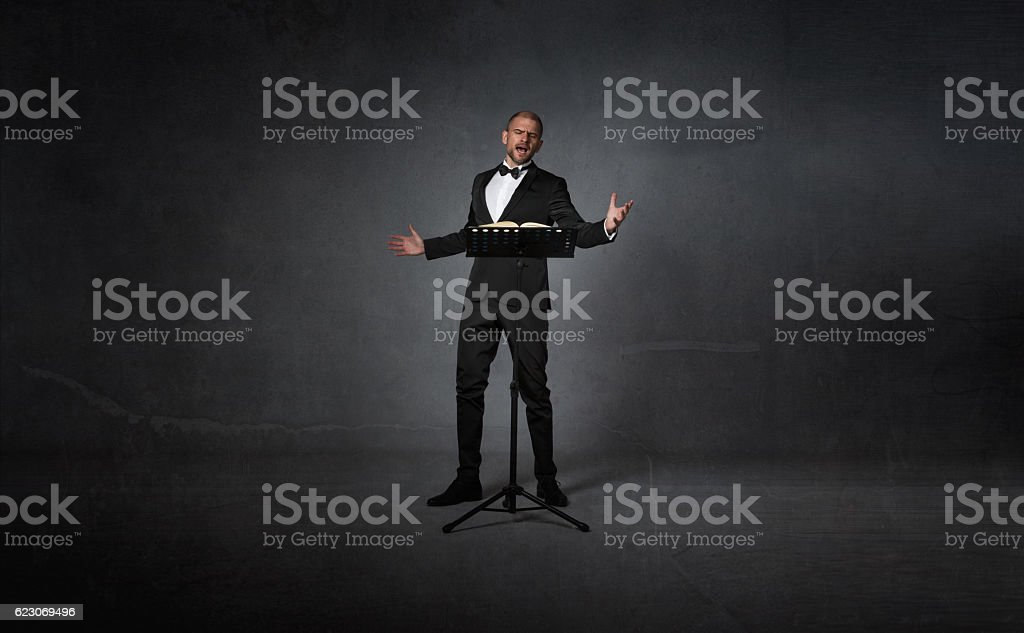 opera singer with lectern stock photo