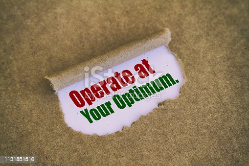 Operate at your optimum written under torn paper.