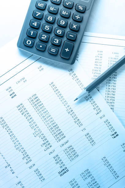 Operating budget, calculator and pencil stock photo