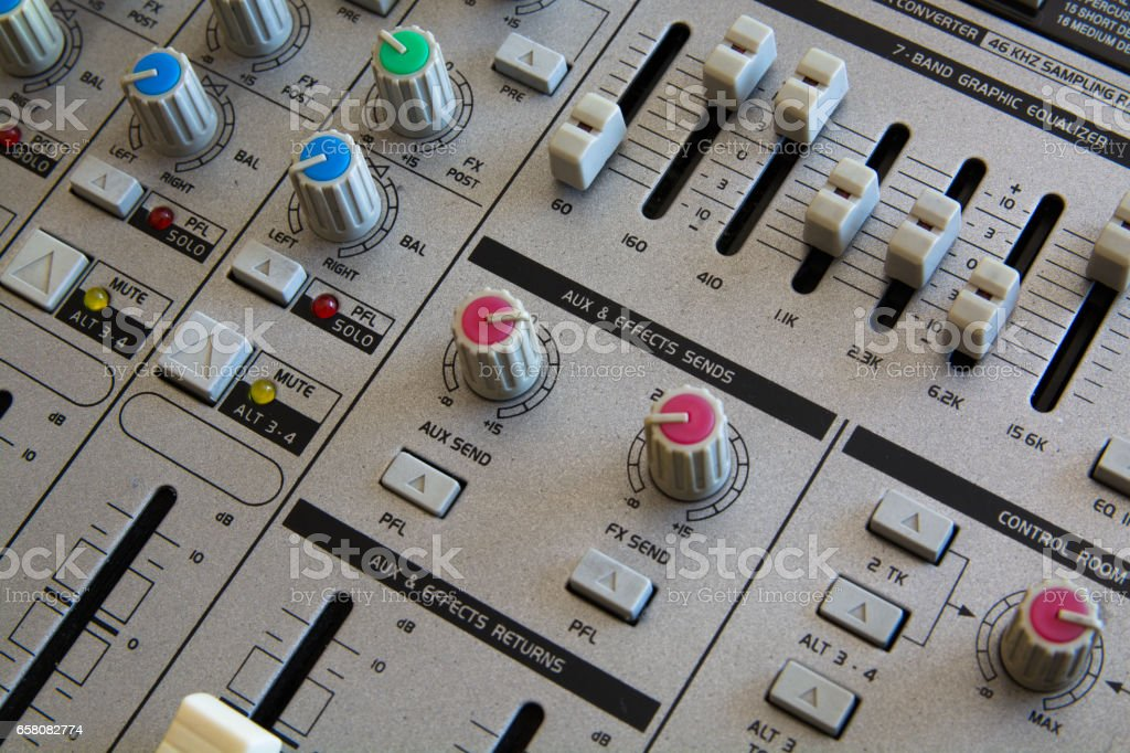 Operating of the Audio Mixer. Close-Up View. royalty-free stock photo