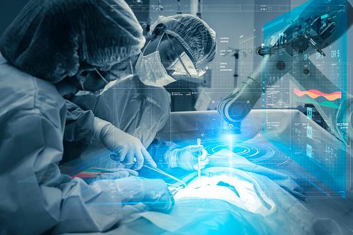 Operating room Doctor or Surgeon anatomy on Advanced robotic surgery machine futuristic virtual interface, robotic surgery are precision, miniaturisation future of tomorrow healthcare and wellness