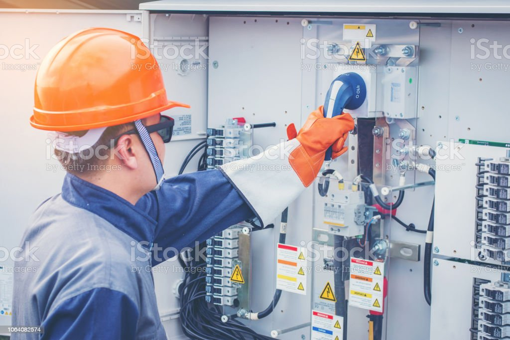 operation and maintenance in solar power plant ; engineering team working on checking and maintenance in solar power plant operation and maintenance in solar power plant ; engineering team working on checking and maintenance in solar power plant Adult Stock Photo