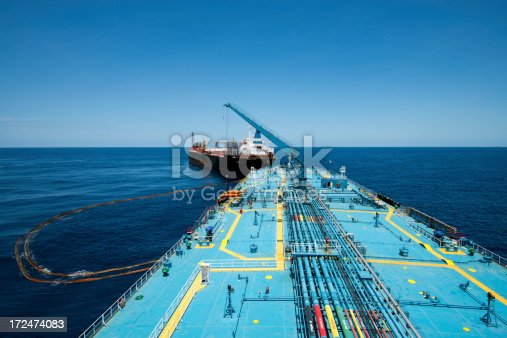 Big crude oil tanker loading from FPSO at the offshore terminal.