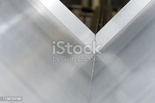 istock operator bending metal sheet by sheet bending machine 1128734180