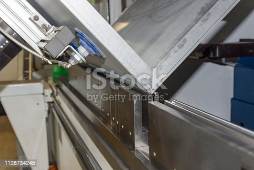istock operator bending metal sheet by sheet bending machine 1128734245