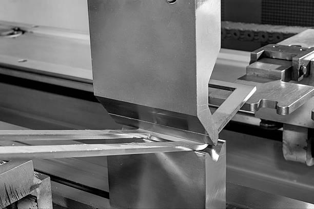 operator bending metal sheet by sheet bending machine operator bending metal sheet by sheet bending machine bending stock pictures, royalty-free photos & images