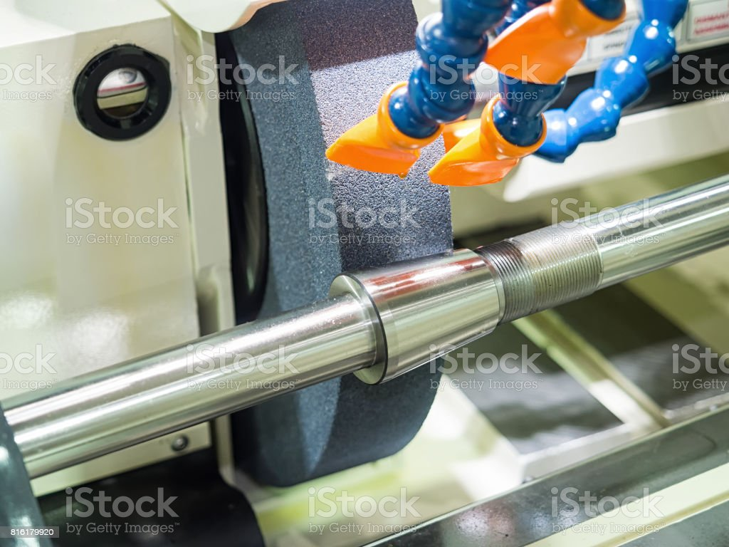 operator grinding forging die parts stock photo